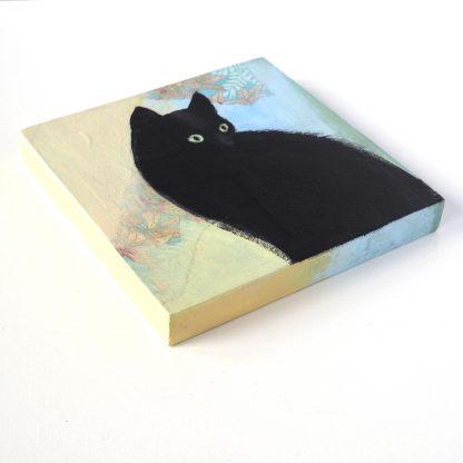 Small black cat, mixed media on panel