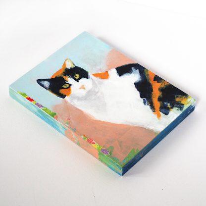 Blue and orange calico cat, mixed media on panel